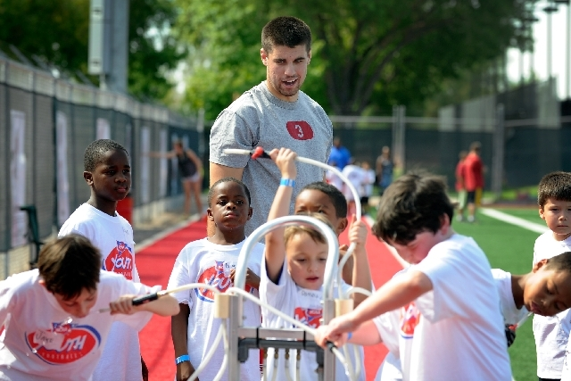 UNLV quarterback Nick Sherry attends a youth football camp Monday at Rebel Park.