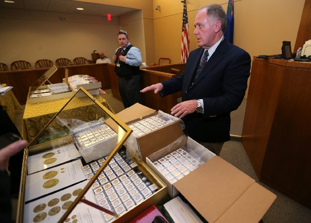 Appraiser Howard Herz talks about gold coins being auctioned off more in Carson City, Nev., on Tuesday, Feb. 26. Sixty-nine-year-old Walter Samaszko, Jr. died in June 2012, leaving thousands of go ...