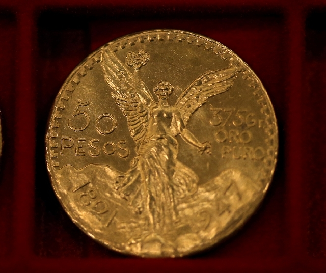 Mexican 50 peso pieces were among the $3.5 million in gold coins auctioned off in Carson City, Nev., on Tuesday, Feb. 26.