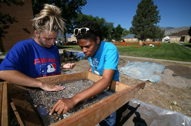 Delaney Childs, left, and Dania Jordan work on an archaeological dig on the grounds of the historic Stewart Indian School in Carson City on Monday. The dig is coordinated through the University of ...
