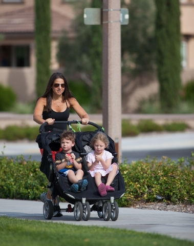 Andrea Behrens exercises by taking a walk with her children Emma, 5, and Noah, 3, at South Tower Park. She wants to be a role model in encouraging her youngsters to embrace healthful eating and ex ...
