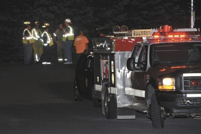 Emergency crews respond to a reported shooting at the Ross Township building that left two people dead, Monday, Aug. 5, 2013 in Saylorsburg, Pa. Monroe County emergency management director Guy Mil ...
