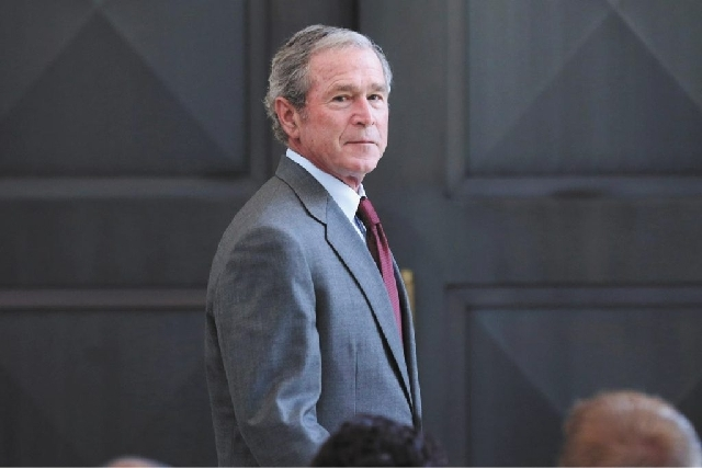 Former President George W. Bush is shown July 10 after giving a speech before a U.S. citizen swearing-in ceremony in Dallas. Bush successfully underwent a heart procedure Tuesday after doctors dis ...