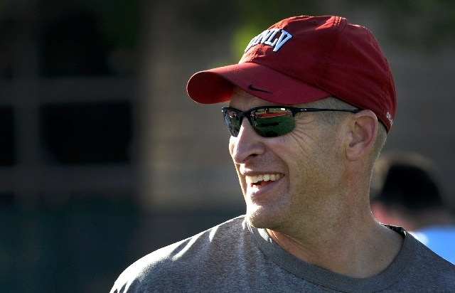 """UNLV coach Bobby Hauck, shown Tuesday at Rebel Park, has yet to guide the Rebels to a road victory in his three seasons. """"We need to just keep getting better and be good enough"""" to win on the road ..."""