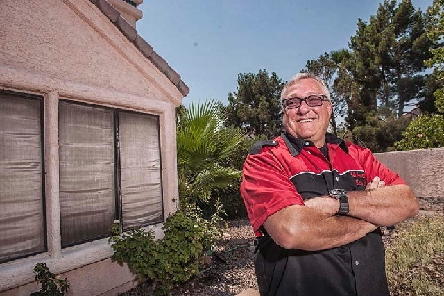 Ken Hall poses at his home in Las Vegas on July 20. Hall recently won a four-year battle to win a mortgage modification on his Las Vegas home.