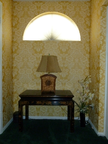 This is an example of poor proportion and scale. The table is too low for this space and the lamp is too small.