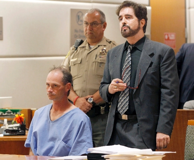 Nathan Louis Campbell, 38, a transient from Colorado, seated left, appears with attorney Phillip Dubee in Los Angeles Superior Court Tuesday. Campbell was charged with murder and assault for alleg ...