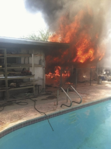 A fire burns on the back patio of a house on the 5600 block of Alta Drive. The fire started about 3 p.m. Tuesday. No injuries were reported.