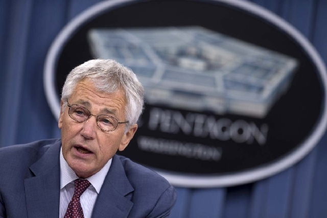 Defense Secretary Chuck Hagel speaks at the Pentagon on July 31. On Tuesday, he approved the decision to cut furloughs for civilian employees from 11 days to six days.