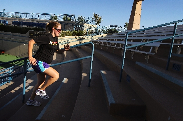 Vanessa Baur, who is 28 weeks pregnant, runs stairs in the summer heat during a private workout session with Las Vegas Bootcamp at the Darling Tennis Center in Las Vegas.