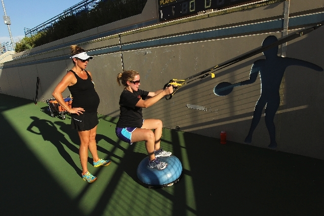 Las Vegas Bootcamp co-founder and trainer Kerry Geyser, left, works with client Vanessa Baur during a private, pregnancy-based session at the Darling Tennis Center in Las Vegas. Geyser, an experie ...