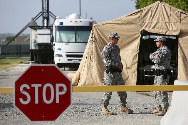 Soldiers guard a security checkpoint Wednesday outside the Lawrence H. Williams Judicial Center where the trial for Maj. Nidal Hasan continues in Fort Hood, Texas.