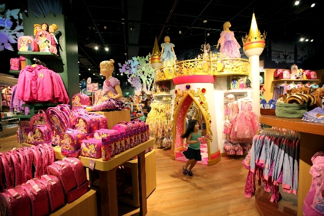 Four-year-old Winter Richer jumps in excitement while looking through the store at the soft opening of the Disney Store at Fashion Show Mall in Las Vegas Wednesday.
