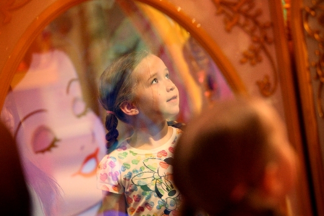 Four-year-old Emma Grover examines a princess and castle display at the soft opening of the Disney Store at Fashion Show Mall in Las Vegas Wednesday.