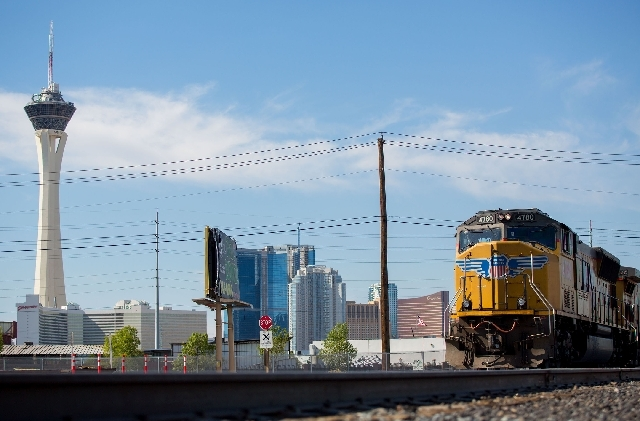 A Union Pacific Railroad train sits parked at the Union Pacific rail yard off Iron Horse Drive on Wednesday as part of a police sting operation.