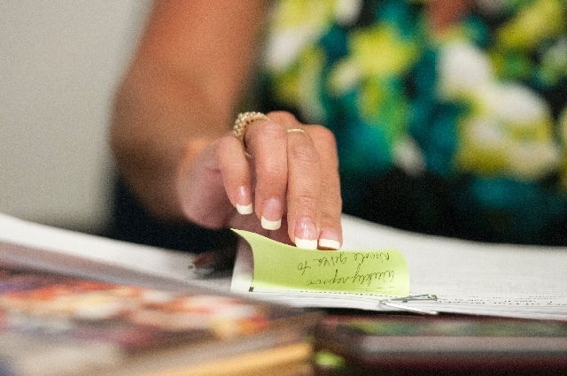 Staci Vesneske goes through her notes during a discussion of of Clark County School District vacancies.