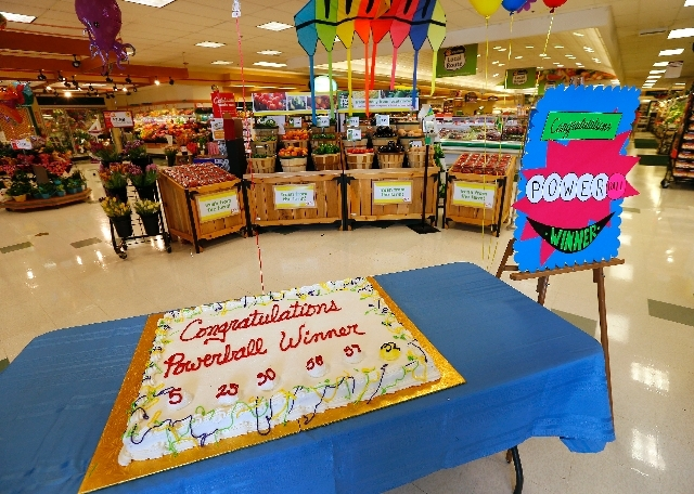 A cake celebrating a Powerball winner sits on a table near the entrance of Stop & Shop in South Brunswick, N.J., Thursday. One of the three winning Powerball tickets was sold at this store, while  ...