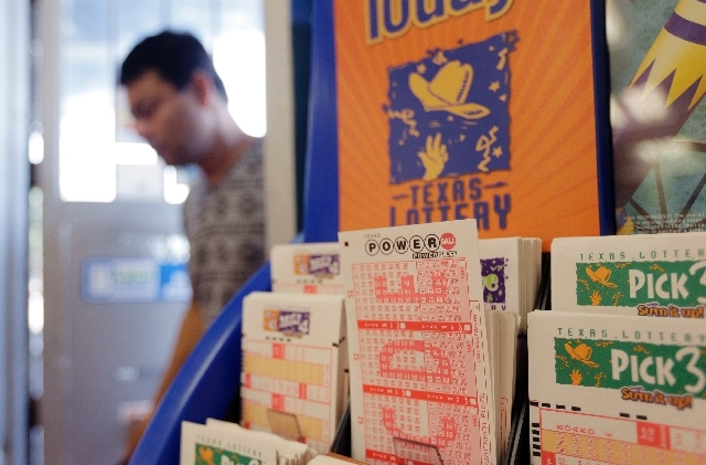 Powerball lottery forms are seen, Wednesday, Aug. 7 in San Antonio. The Powerball jackpot is expected to be about $425 million by Wednesday's drawing, making it the game's third largest ever. Sue  ...