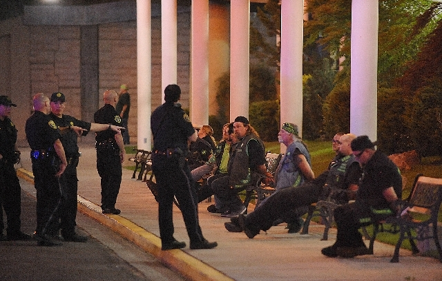 Police officers keep an eye on handcuffed men on Sept. 23, 2011, after a shooting at John Ascuaga's Nugget in Sparks. The incident involved members of rival motorcycle gangs, the Vagos and Hells A ...