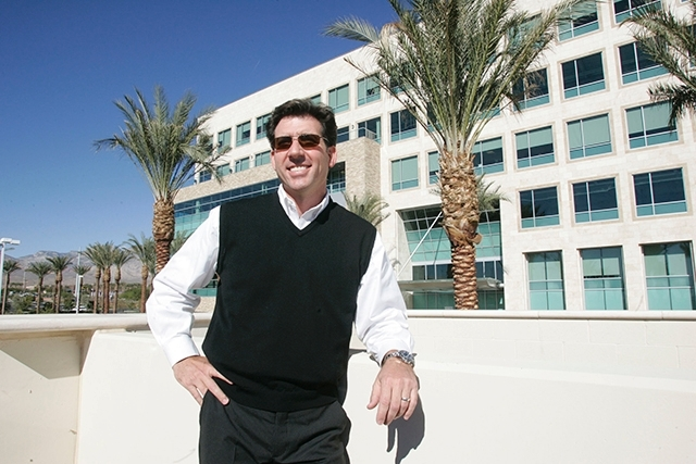 Frank Gatski, chief of Gatski Commercial Real Estate Services, stands outside the Pavilion office in 2008.