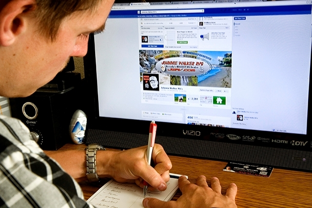 Johnnie Walker RV marketing director Michael Walker works on the company's Facebook page Aug. 6.