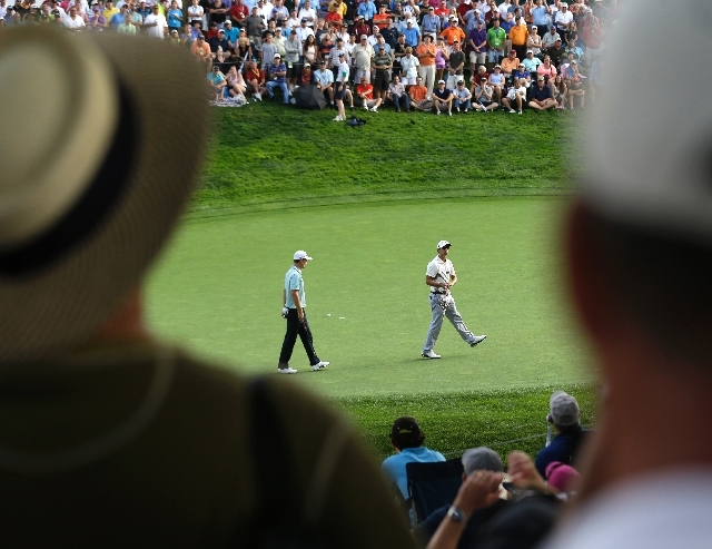 Adam Scott, of Australia, right, reacts after missing a birdie putt, as Justin Rose, of England, looks on at the 13th hole during the first round of the PGA Championship golf tournament at Oak Hil ...