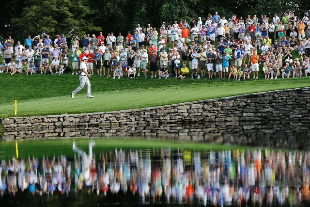 Adam Scott, of Australia, walks to the 15th green during the first round of the PGA Championship golf tournament at Oak Hill Country Club, Thursday in Pittsford, N.Y.