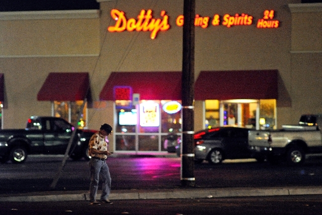 A pedestrian uses his phone while crossing Mayorga Street at Boulder Highway on Friday. Police say alcohol can impair pedestrians' judgment, leading them to cross a road in the wrong place or cros ...