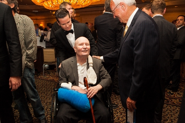 Former boxing referee Mills Lane, seated, attends Saturday's ceremony with son Terry, rear. Lane, 76, is one of 19 members of the inaugural Nevada Boxing Hall of Fame class.
