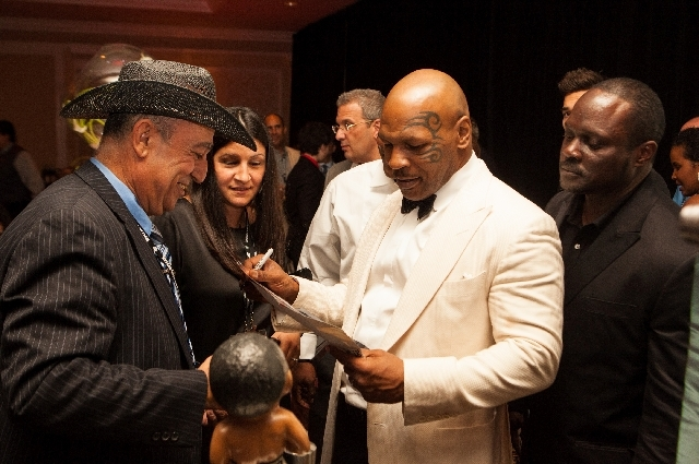 Mike Tyson signs autographs Saturday night during the inaugural induction ceremony of the Nevada Boxing Hall of Fame at the Monte Carlo. Tyson, 47, became the youngest boxer to hold the WBC, WBA a ...