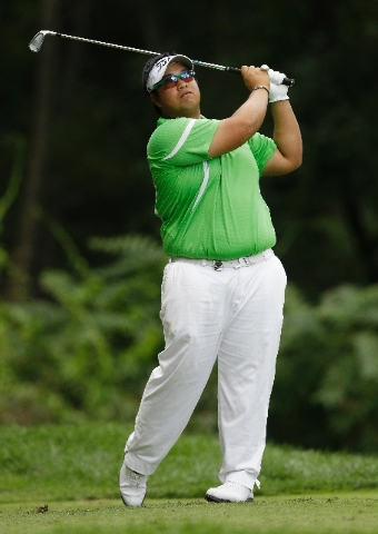 Kiradech Aphibarnrat, of Thailand, watches his tee shot on the third hole during the final round of the PGA Championship golf tournament at Oak Hill Country Club, Sunday.