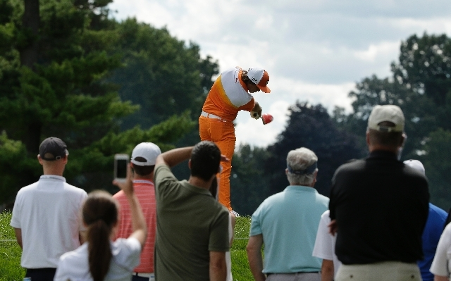 Rickie Fowler hits his tee shot on the ninth hole during the final round of the PGA Championship golf tournament at Oak Hill Country Club, Sunday.