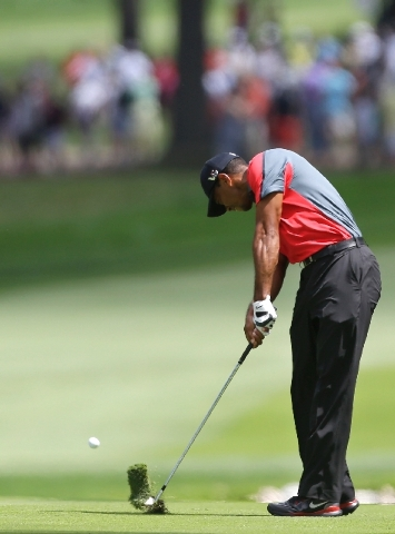 Tiger Woods hits from the fairway on the 13th hole during the final round of the PGA Championship golf tournament at Oak Hill Country Club, Sunday in Pittsford N.Y.