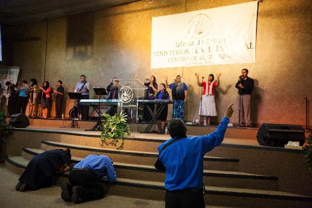 Members of the congregation sing and pray Sunday during a service at Iglesia de Cristo in North Las Vegas. On Thursday, a hit and run accident involving parishioners from the church occurred as pe ...