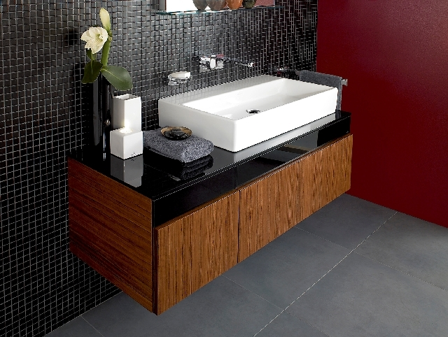 This sink/cabinet is functional, attractive and would make a great statement in a powder room.