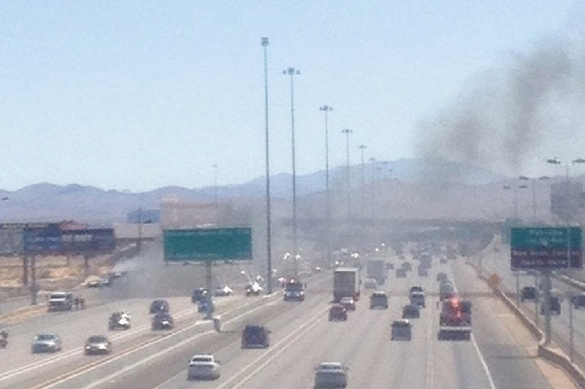 A tractor-trailer is on fire in the northbound lanes of Interstate 15 near Blue Diamond Road, blocking traffic Monday afternoon.