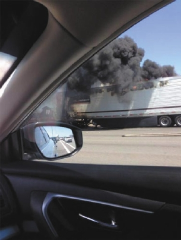 A tractor-trailer on fire on Interstate 15 at Blue Diamond Road is blocking traffic in the northbound lanes Monday afternoon.