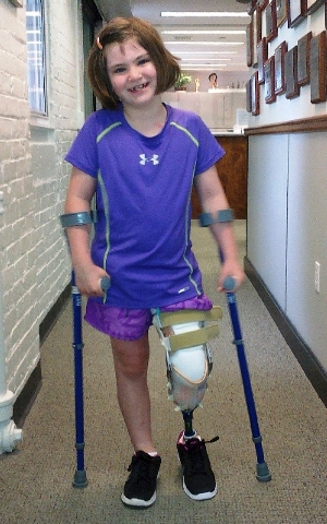 This photo released Thursday by the Richard family shows Jane Richard, 7, who lost part of her left leg in the Boston Marathon bombings on April 15 walking on a prosthetic leg in Boston. The famil ...