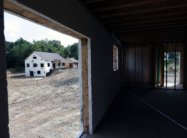 A zero net energy home under construction is seen from the interior of another in July at The Preserve at Mountain Vista in New Paltz, N.Y. U.S. developers broke ground on homes at a faster pace i ...