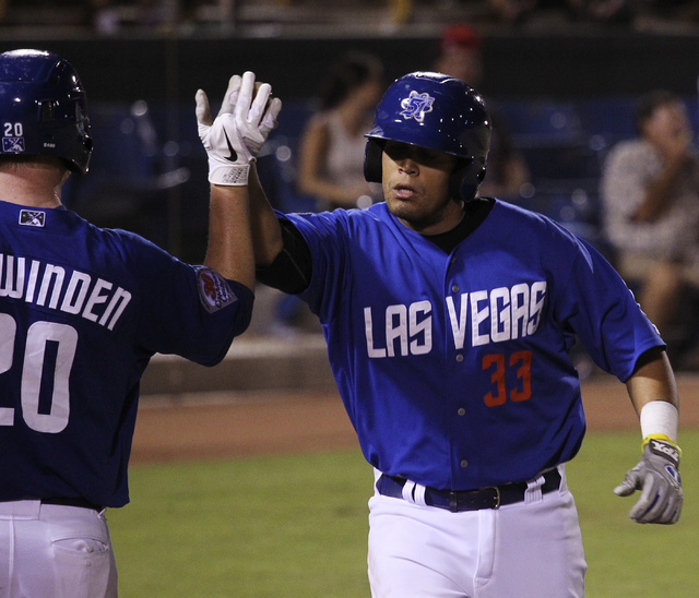 The 51s Francisco Pena (33) gets congratulated after hitting a home run in the fourth inning against Tucson at Cashman Field in Las Vegas on Aug. 31, 2013. (Jason Bean/Las Vegas Review-Journal)