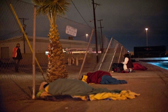 Volunteer Rodney Davis, left, searches the streets of downtown Las Vegas counting homeless people for a community wide homeless count Jan. 24, 2013. (Martin S. Fuentes/Las Vegas Review-Journal)