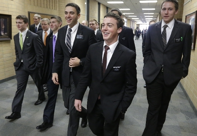 Mormon missionaries walk through the halls at the Missionary Training Center in Provo, Utah in January.