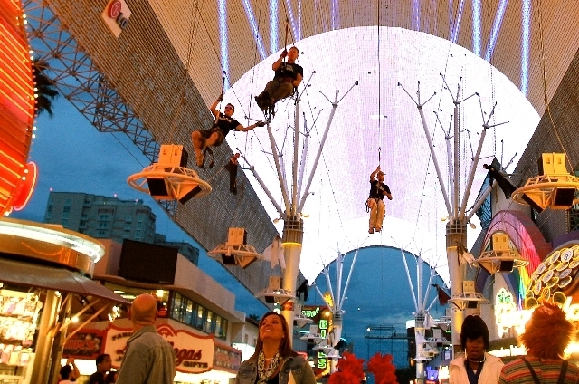 Thrill seekers take a ride on the Fremont Street Flightline attraction under the Fremont Street Experience canopy.