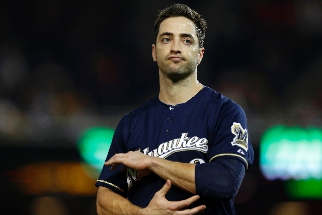 File-This Sept. 21, 2012 file photo shows Milwaukee Brewers Ryan Braun reacting while holding his elbow after missing his swing during a baseball game against the Washington Nationals at Nationals ...