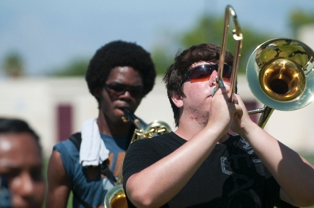 Senior Abrey Liggins, left, and junior James Lindsay, right, play July 31 during a marching band practice at Eldorado High School, 1139 N. Linn Lane. In an effort to revive the fine arts program a ...