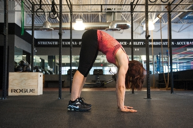 Without bending the knee, walk the feet up toward the hands. This will make the hips pike up. When you feel a slight stretch in the hamstrings, stop walking the feet and begin walking the hands un ...