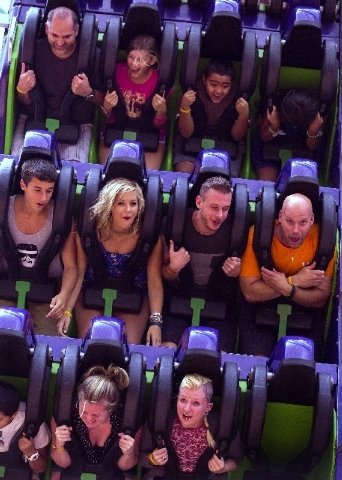 People ride the Inverter at Adventuredome. The theme park will introduce a new ride later this year, part of its efforts to maintain interest in the attraction. (Samantha Clemens/Las Vegas Review- ...