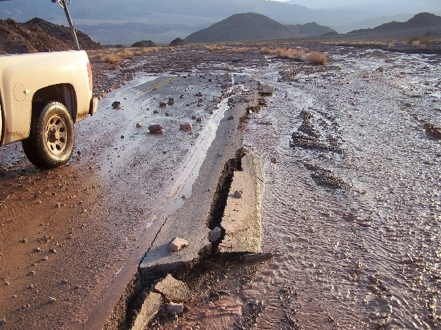 A section of Badwater Road in Death Valley is shown after it was washed out by flash flooding during a rain storm last month.