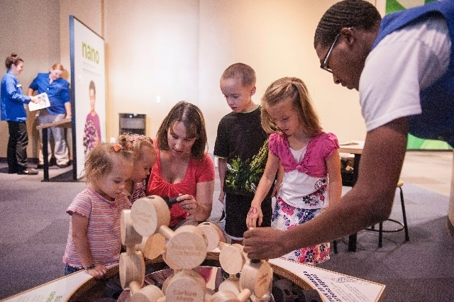 From left, twins Lydia and Ainsley Hardman, 2, play with their mom, Melissa, and sibling twins Tanner and Kayla, 6, and volunteer Trashawn Young at Discovery Children's Museum.
