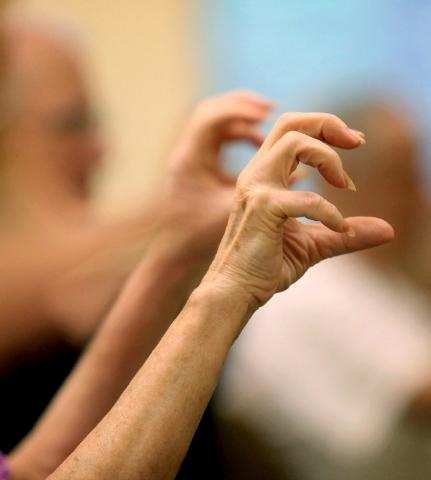 A senior creates a clawing motion.
